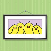 Cute Family Portrait of Yellow Chicks in Picture Frame Hanging on Green Wallpaper Background