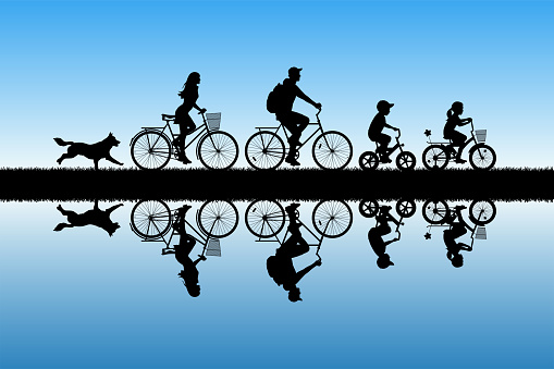 Family on bikes in park
