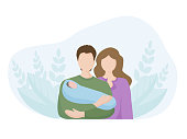Family with a newborn child. The father holds a small child in his arms, the mother stands beside him. The concept of family values, motherhood and paternity . background of the leaves with nature.