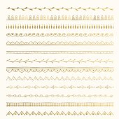 Gold hand drawn fancy borders and dividers. Ink and brush vector illustration.
