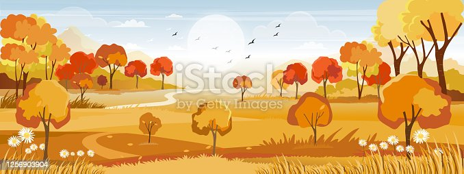 istock Fantasy panorama landscapes of Countryside in autumn,Panoramic of mid autumn with farm field, mountains, wild grass and leaves falling from trees in yellow foliage. Wonderland landscape in fall season 1256903904