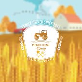 Farm And Agriculture Badge over a Blurred Farm Scene