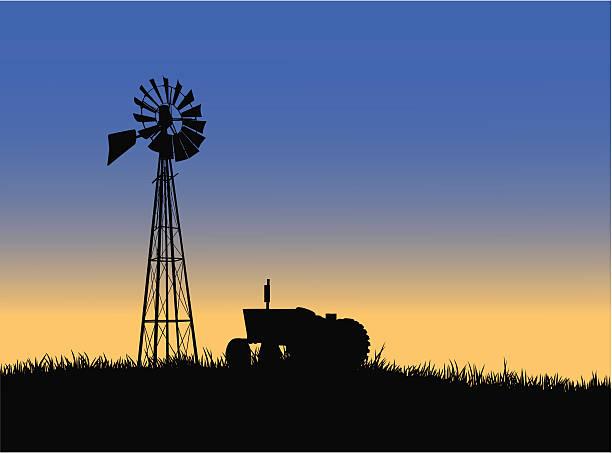 Farm tractor with windmill vector art illustration