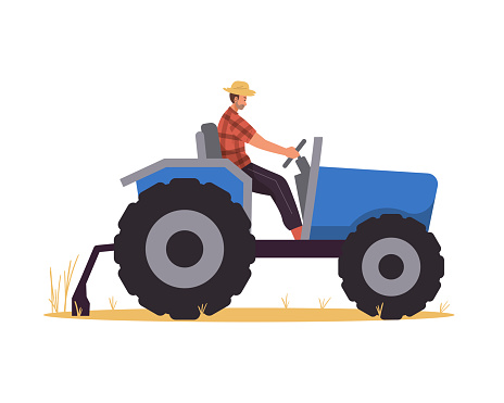 Farmer riding tractor in the field