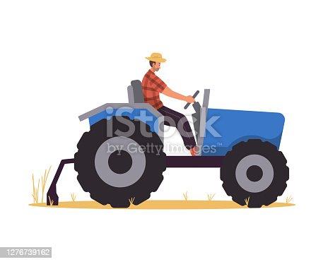 istock Farmer riding tractor in the field 1276739162