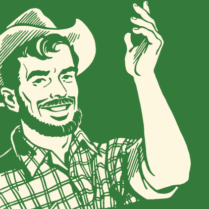 A farmer with a beard making hand gestures