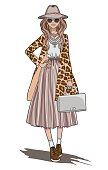 Fashion girl. Beautiful young girl in leopard print coat and grey bag in her hands.