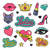 Vector illustration of female symbols and icons, such as kissing lips, lipstick, cat, shoe, crown, strawberry and heart. Isolated on background.