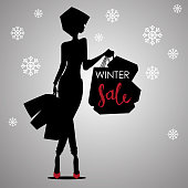 Fashion shopping woman black silhouette in red high heels with shopping bags with sign Winter Sale advertising with snowflakes background template - vector illustration