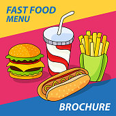 Fast food set. Hamburger, french fries, hot dog and soft drink in cup with straw on bright striped background.