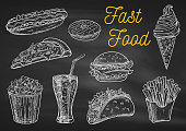 Fast food chalk sketch icons on blackboard. Snacks, desserts, drinks. Isolated vector french fries in box, pizza slice, soda coke, cheeseburger, hamburger, hot dog, ice cream, popcorn, tacos donut