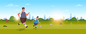 fat overweight father with obese son playing football over size family having fun on green lawn at park weight loss activity concept horizontal landscape background full length