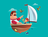 father and son having fun with sailing boat