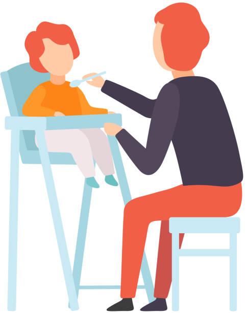 vater fütterung baby, das auf dem hochstuhl sitzt, eltern, die sich um seine kindervektor-illustration kümmern - hausmannskost stock-grafiken, -clipart, -cartoons und -symbole
