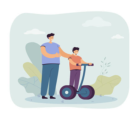Father standing next to son riding segway