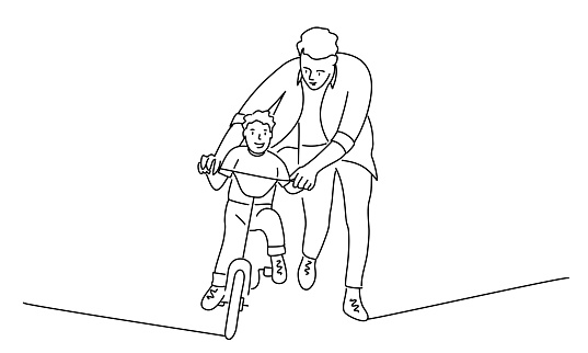 Father teaches son to ride a bike.