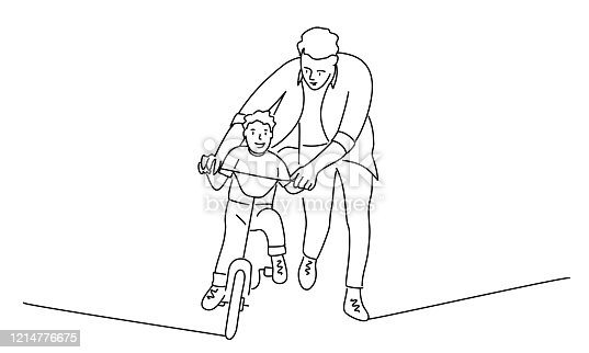istock Father teaches son to ride a bike. 1214776675
