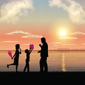 Father's Day background[Father and child in the sunset]