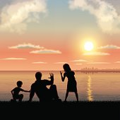 Father's Day background[Father and children in the sunset]
