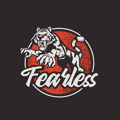 Fearless slogan with tiger drawing retro texture for t-shirt design, vector illustration element vintage style. Old look with grunge texture.