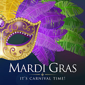 An invitation to the masquerade party for the Mardi Gras with feather party mask on on the blue and purple colored background