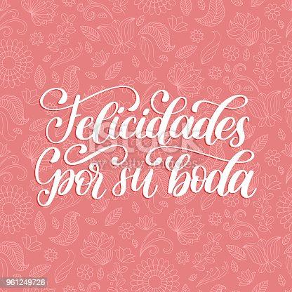istock Felicidades Por Su Boda translated from Spanish handwritten phrase Congratulations For Your Wedding on pink background. 961249726