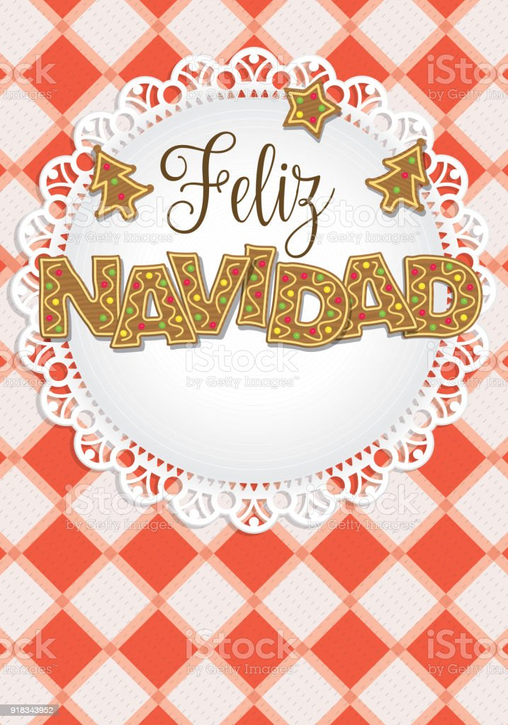 feliz navidad merry christmas in spanish language lettering formed by gingerbread cookies on a