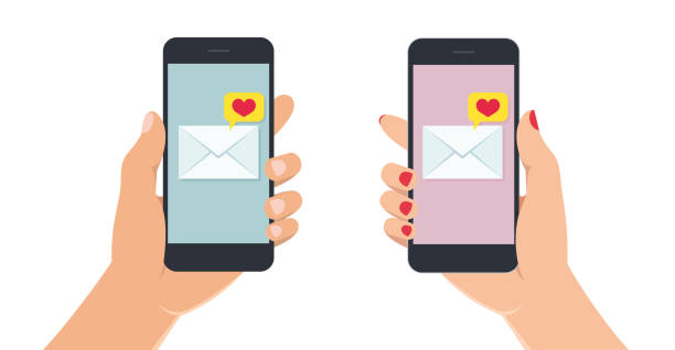 stockillustraties, clipart, cartoons en iconen met vrouwelijke en mannelijke handen met smartphone met liefde bericht op het scherm. hand met mobiele telefoon op witte achtergrond. - menselijke hand