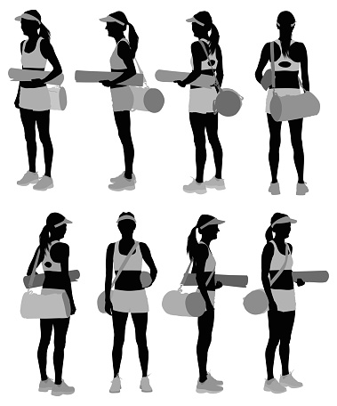 Female athlete with exercise mat and gym bag