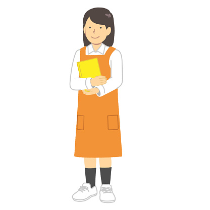 A female bookstore clerk in an apron