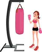 A lady doing boxing workout with heavy bag.