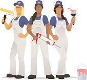 Group of female decorators with rollers, paintbrushes, sealant gun and paint can.