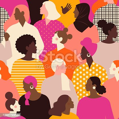 istock Female diverse faces of different ethnicity seamless pattern. Women empowerment movement pattern. International women's day graphic in vector. 1202799535