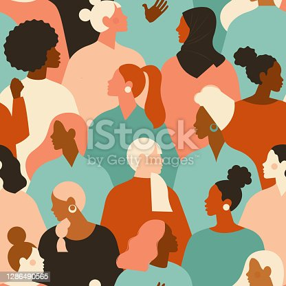 istock Female diverse faces of different ethnicity seamless pattern. Women empowerment movement pattern. International womens day graphic in vector. 1286490565