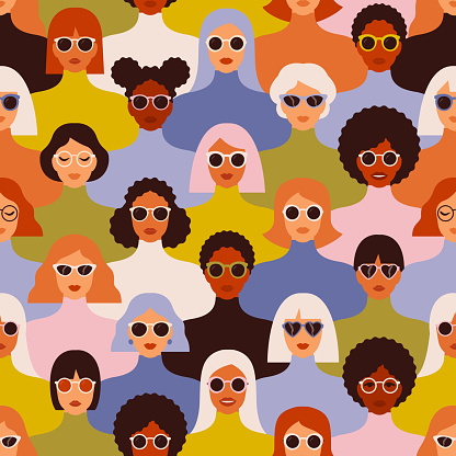 Female diverse faces of different ethnicity seamless pattern. Women empowerment movement pattern. International women s day graphic in vector.