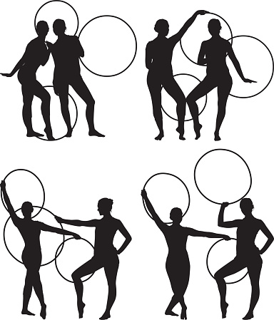 Female gymnasts dancing with hoops