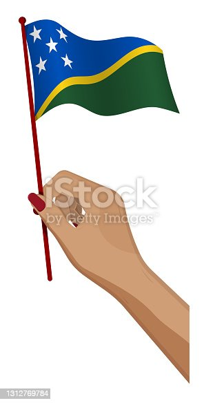 istock Female hand gently holds small flag of Solomon Islands. Holiday design element. Cartoon vector on white background 1312769784