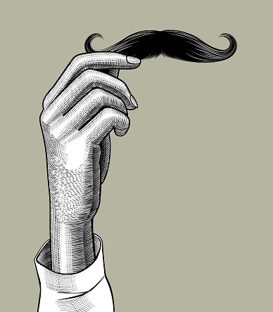 Female hand holding a male mustache