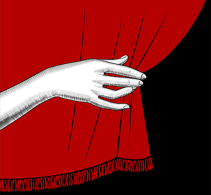 Female hand pulling aside the red curtain on black background
