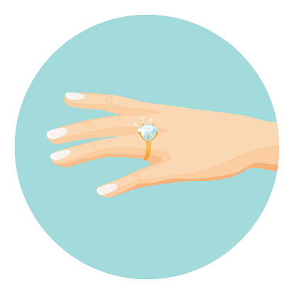 Female hand with diamond engagement ring on finger