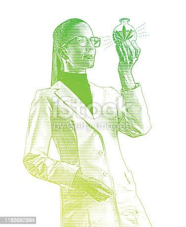 istock Female lab technician examining beaker of CBD Oil 1183692994
