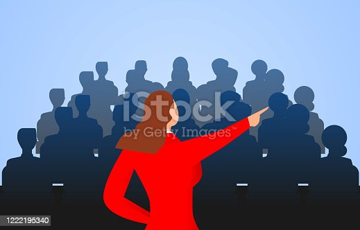 1069233370 istock photo Female leader standing in front of a group of people speaking 1222195340