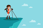 Female photographer taking photo on top of mountain, flat design vector.