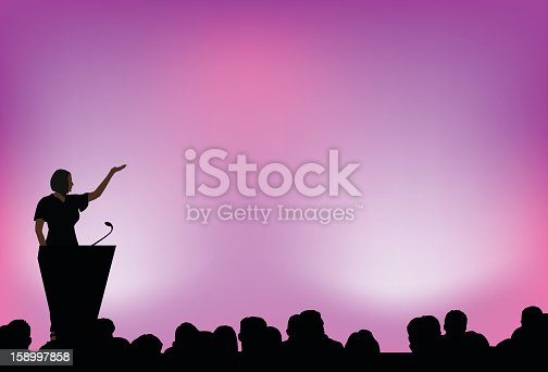 istock A female presenting to an audience in front of purple lights 158997858
