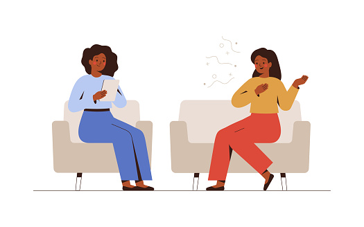 Female psychotherapist has an Individual session with her patient and sees positive results. Happy Woman sits on the sofa and excitedly tells something to her counselor.