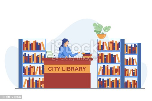 istock Female smiling librarian standing at counter 1265171600