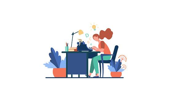 Female writer using retro typing machine