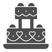 istock Festive cake with hearts solid icon, Birthday cupcake concept, wedding cake sign on white background, wedding creamy dessert icon in glyph style for mobile and web. Vector graphics. 1283973719