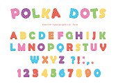 Festive polka dots font. Colorful ABC letters and numbers. Funny alphabet for kids. Isolated on white. Vector.