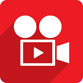Vector illustration of a red film camera with play button icon in flat style.